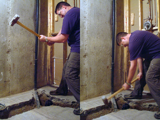 Matt breaking the concrete floor in our basement bathroom