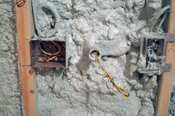 Electrical outlets encased in spray foam insulation