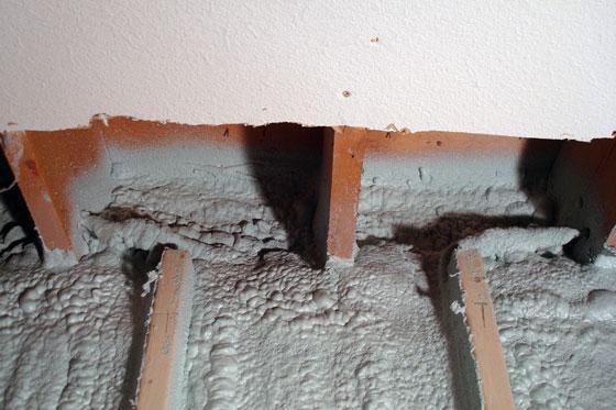 Spray foam insulation in the joist headers