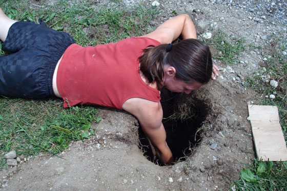 Reaching into a post hole