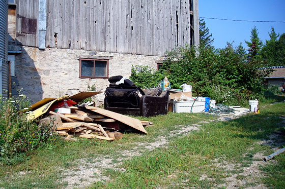 Garbage pile by the barn