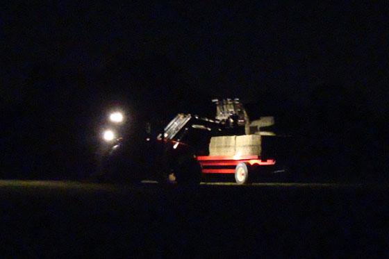 Loading hay bales in the dark