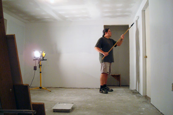 Matt priming the long room with the roller