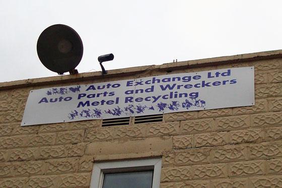 Misspelled scrap metal sign