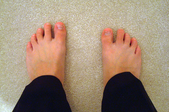 Standing on carpet in barefeet