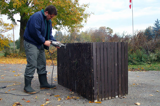 Matt cuts a large crate with a sawzall