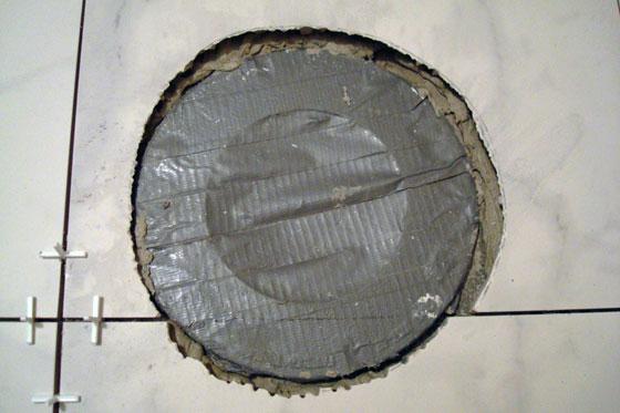 Tile cut around toilet flange
