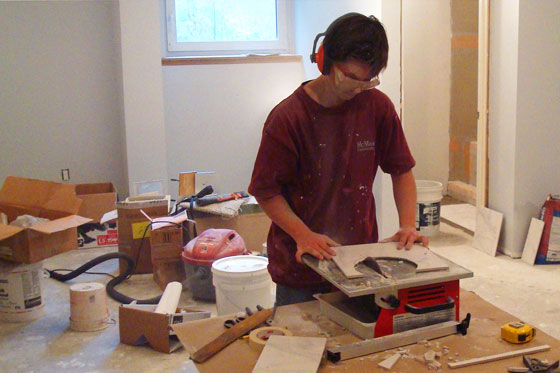 Cutting tile on a wet saw