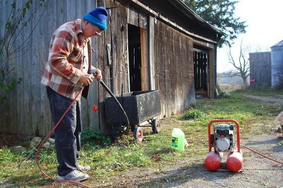 Using an air compressor to clear a water line