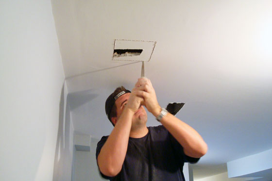 Matt cuts the hole in the ceiling