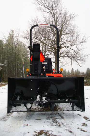 Rear mounted snowblower on a tractor
