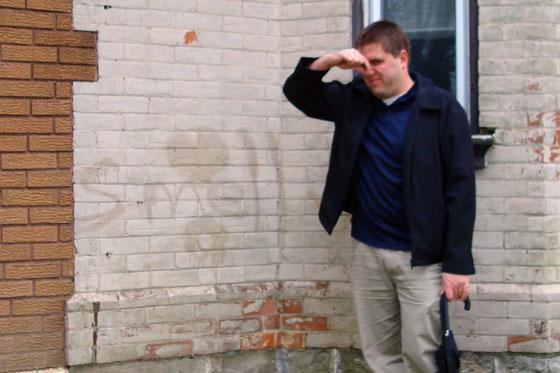 Painted over graffiti on brick
