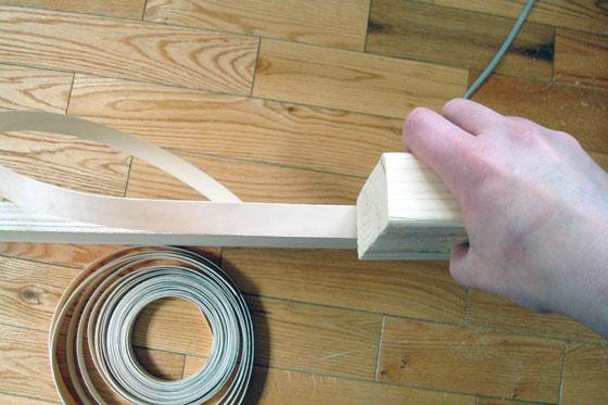Pressing veneer edging onto plywood