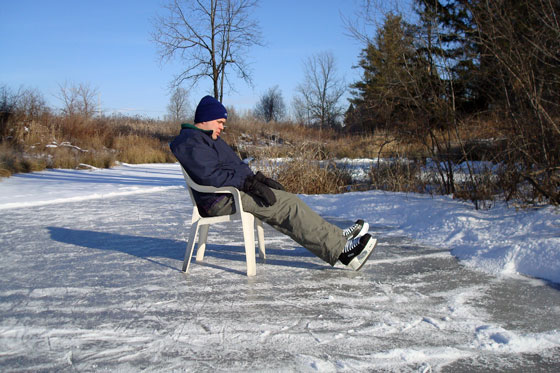 Taking a skating break in a lawn chair on the ice