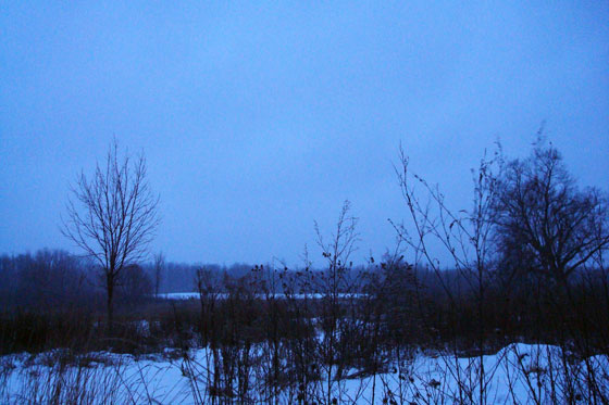 Snow clouds at dusk on the farm