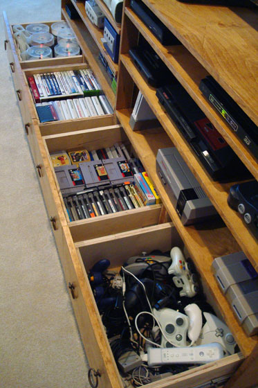 Drawers in a TV cabinet for video games