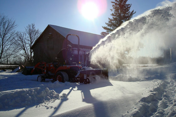 Clearing the driveway with the snowblower on the tractor