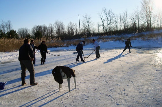Playing hockey on a frozen pond