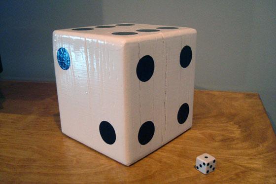 Big dice beside a little dice