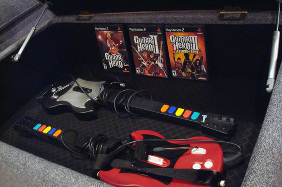 Guitar Hero games and guitars inside the DecorRest storage ottoman