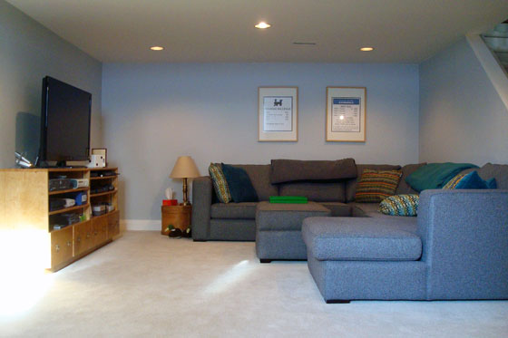 TV area with sectional couch in the basement
