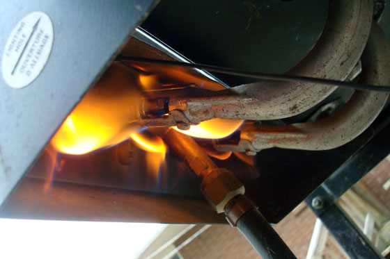 Propane barbecue fittings on fire