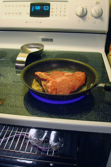 Cooking steak and potatoes on the stove