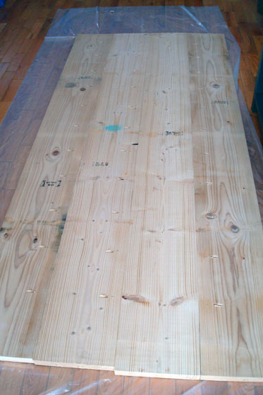 Back side of a wood counterop showing holes from the Kreg Jig