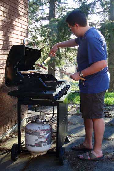 Barbecuing hotdogs and hamburgers