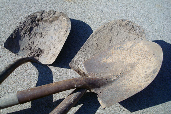 Round mouth shovels with dried dirt stuck to them