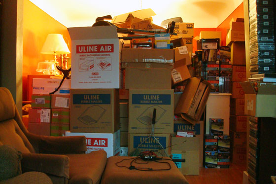 Items from the basement stacked in the dining room