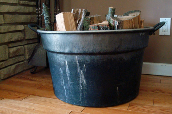 Old wash tub filled with firewood