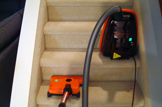 Vacuuming stairs with a canister vacuum