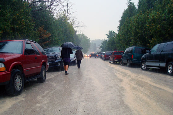 Walking down a country road in a rain storm