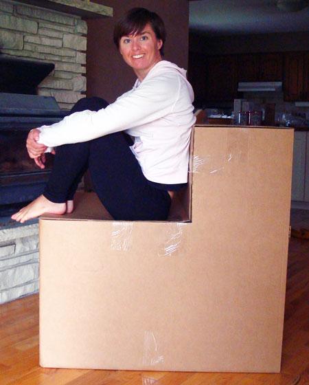 Sitting on a cardboard box