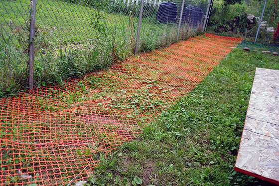 Mesh fencing laid flat on the ground