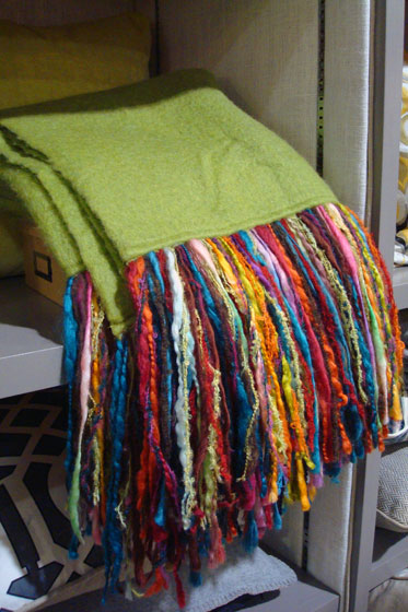 Green mohair throw with multicoloured fringe by Andrea Hylton