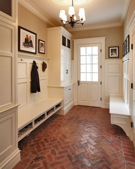 Mudroom with built in cabinetry and brick floor