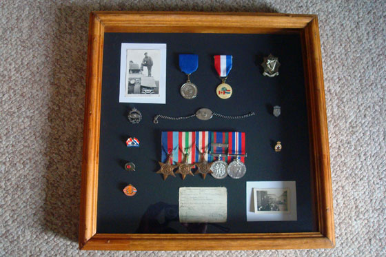 World War II medals and mementos in a shadow box