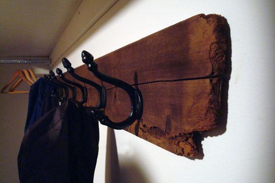 Wrought iron hooks on a barn board backer