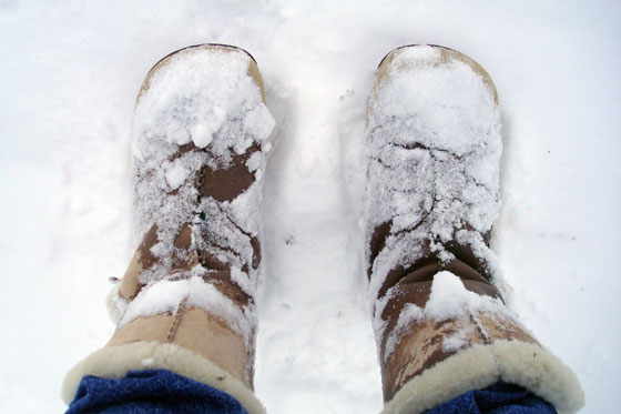 Wet and snow-covered winter boots