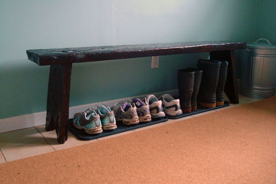 Rustic wood bench in a mudroom