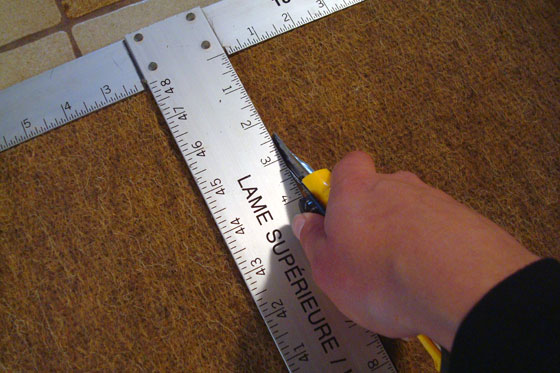 Cutting a rug using a drywall square