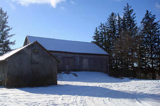 Barns on a sunny, snowy winter morning