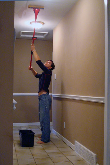 Mopping the ceiling to prepare for painting