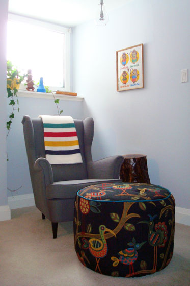 Colourful reading nook featuring Ikea Strandmon wing chair