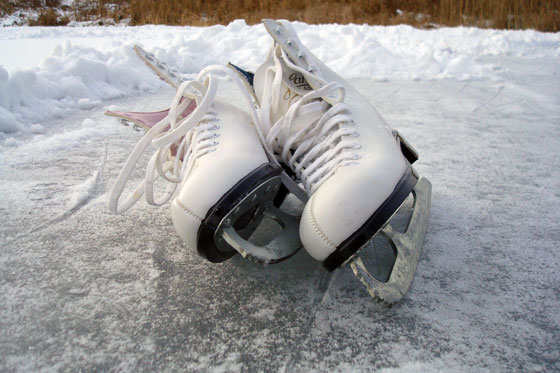Ice skates on a frozen pond