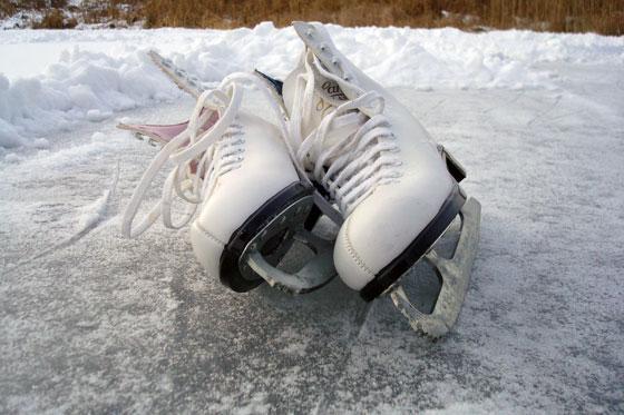 Ice skates on a frozen pond