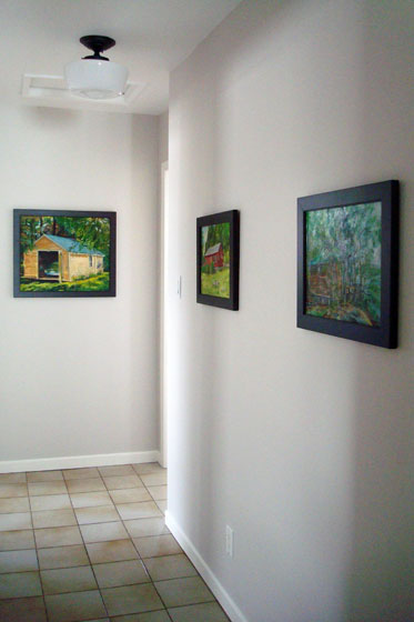 Paintings hung in the hallway