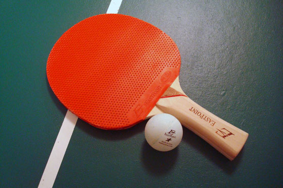 Pingpong paddle and ball on a table